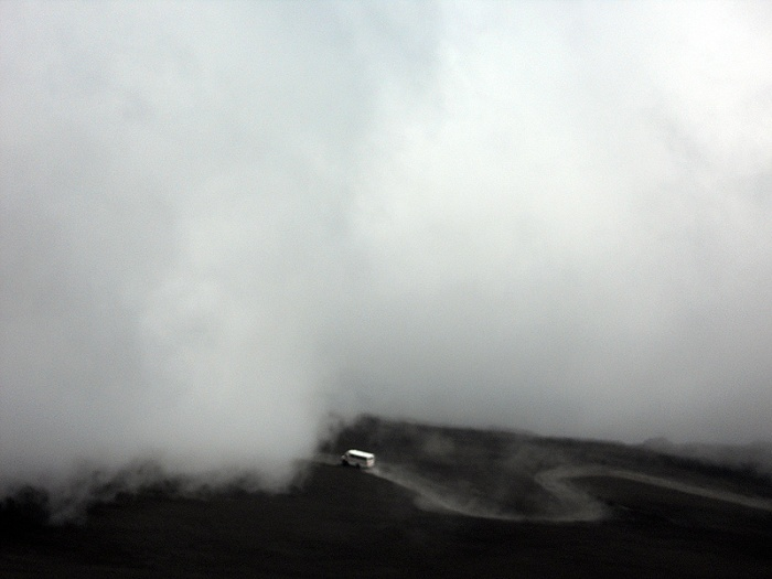 Travel photo Sicily Mount Etna - jeep driving through clouds up towards Torre del Filosofo by David J Rodger