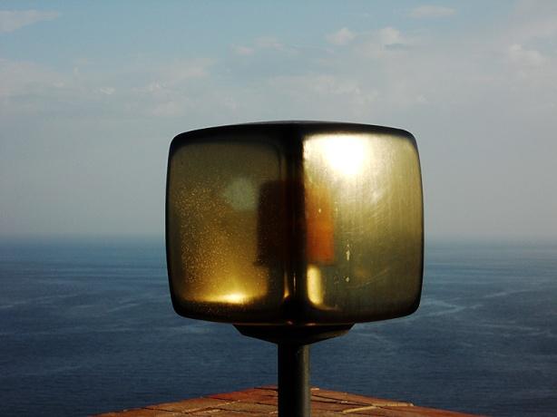 Travel photo - Sicily - Taormina -  warning light against sea horizon by David J Rodger