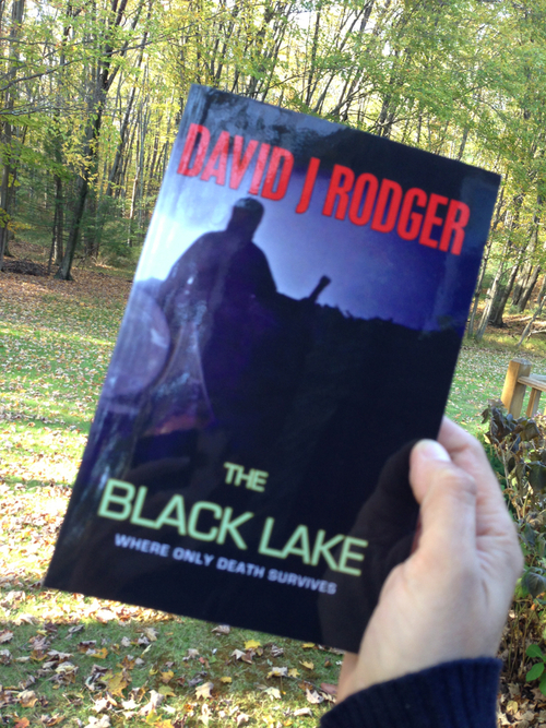 Photo of fan holding copy of David J Rodger's paperback The Black Lake - Catskill Mountains New York State