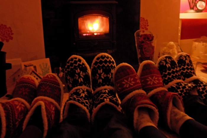 cosy night in front of the fire with friends photo of slippers and wood burning stove