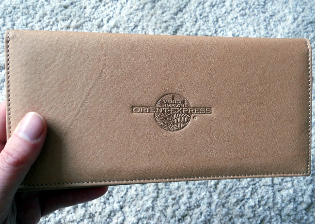 Orient Express leather ticket pouch held by British Sci-fi Dark Fantasy author David J Rodger