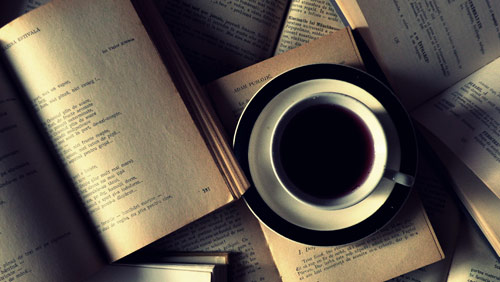 Photo of books and coffee cup - credit ~xRinei on deviantART