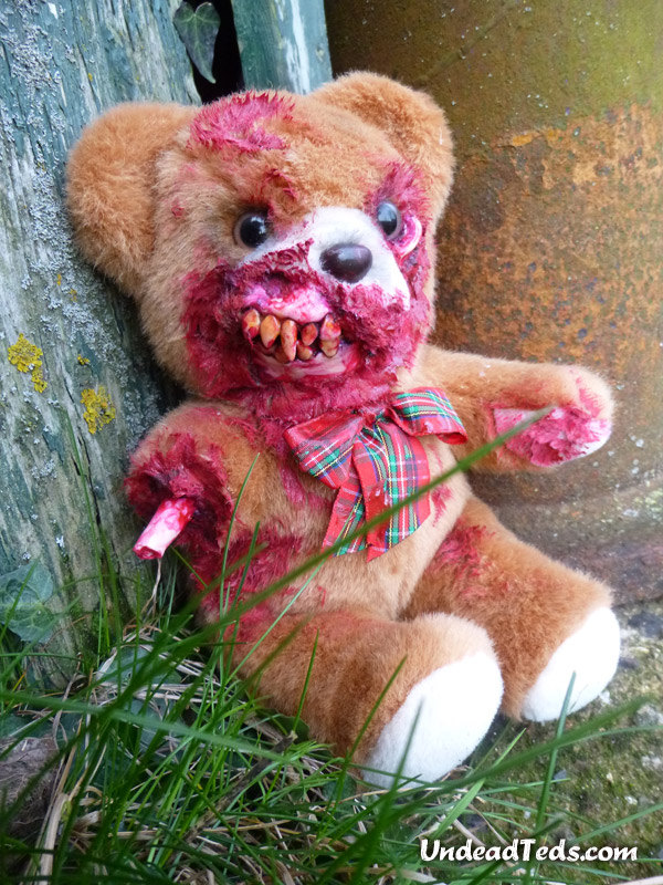 zombie teddy bear UnDead Ted with eaten-away face exposing jaw teeth and torn-off arm by Phillip Blackman