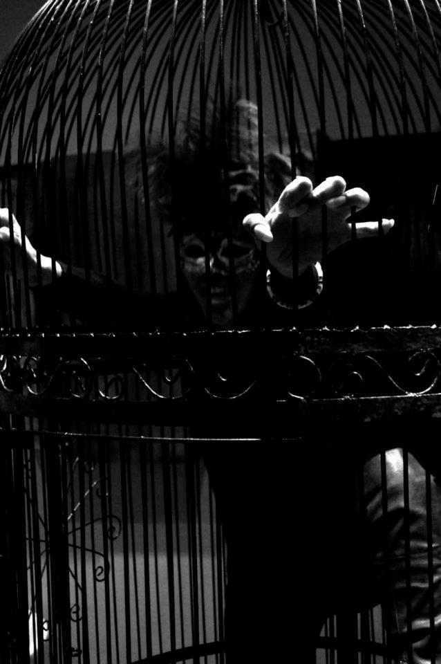 Goblin Market - photo of demonic human creature in a cage image John De Cristofaro - all rights reserved