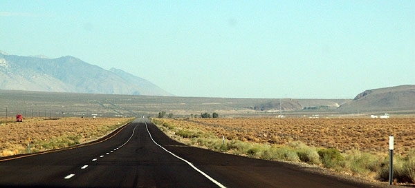 Photo California Highway 395 deserted road through post-apocalyptic landscape - image David J Rodger - All Rights Reserved