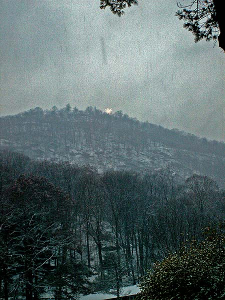 Photo New England eerie light glows on forest covered mountain peak - image David J Rodger - All Rights Reserved