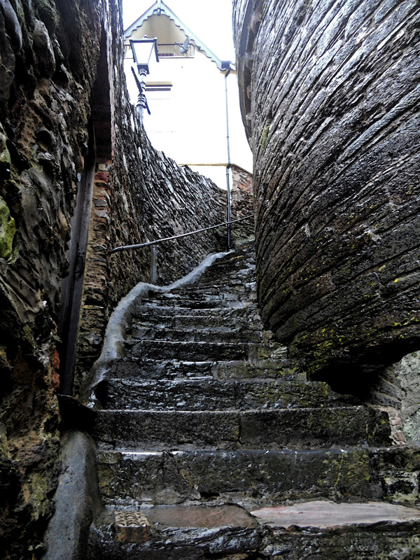 Centuries Worn Steps - ancient stone staircase leading from harbor - Dartmouth Devon UK
