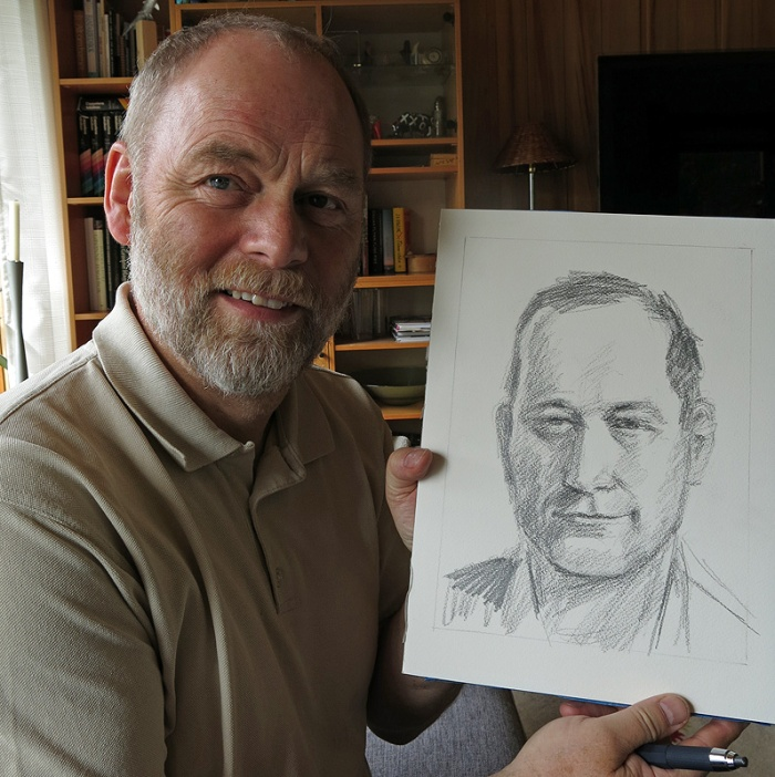 Norwegian artist holds a sketch of David J Rodger