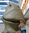 Photo young girl shocked by a giant smiling turd - Oslo - Outside Astrup Fearnley museum Copyright David J Rodger