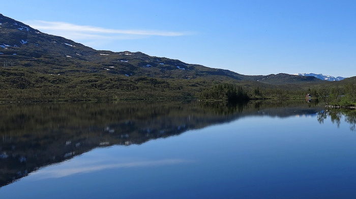Travel photo driving north from Narvik to Tromso on E6 - moorlands reflected in blue fjord - copyright David J Rodger