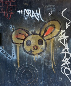 street art graffiti Mostar Bosnia yellow mouse on black metal