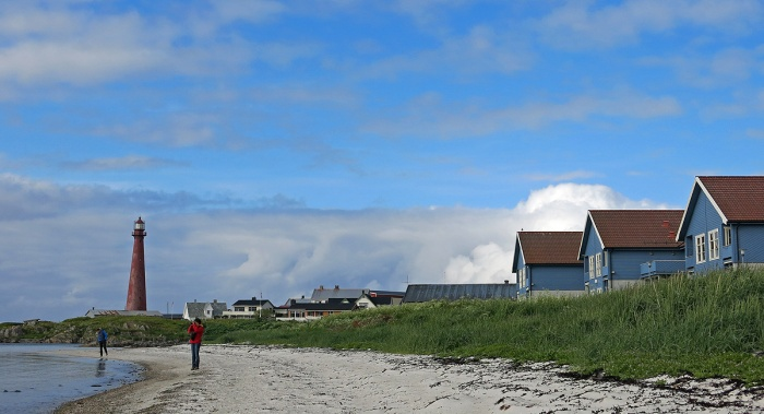 Travel photo Andenes lighthouse and blue painted houses on beach front - Vesterålen Islands - copyright David J Rodger