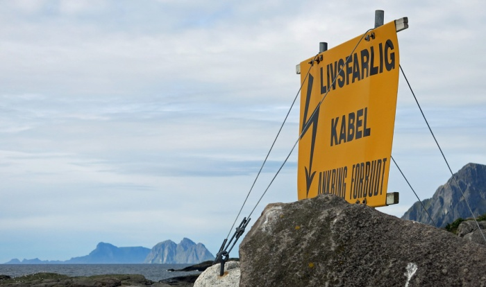 travel photo arctic circle  Norway - danger electric cable sign at Å - image copyright David J Rodger