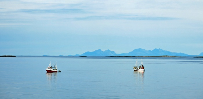 travel photo arctic circle  Norway - fishing boats heading out to sea around Bodo - image copyright David J Rodger