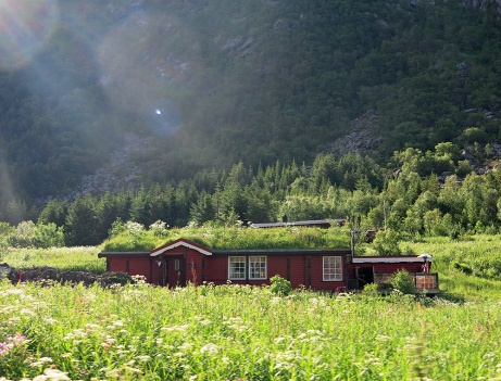 travel photo arctic circle Norway - Scandinavian cottage with grass roof - image copyright David J Rodger