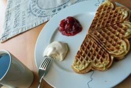travel photo arctic circle Norwegian waffle cake at Karoline Cafe - Nusfjord - image copyright David J Rodger