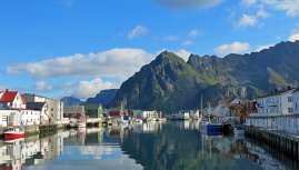 travel photo Henningsvaer arctic circle norway - stunning waterside view with mountains reflecting on surface - image copyright David J Rodger