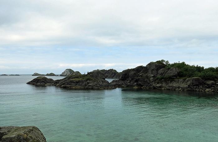 Travel photo Norway Norway - Senja Island - hitting the coastline - ragged rocks and flat horizon