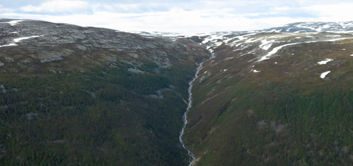 Travel photo Norway - Tromsø - view from  Mount Fløya - giant flank of mountain and meltwater stream - copyright David J Rodger