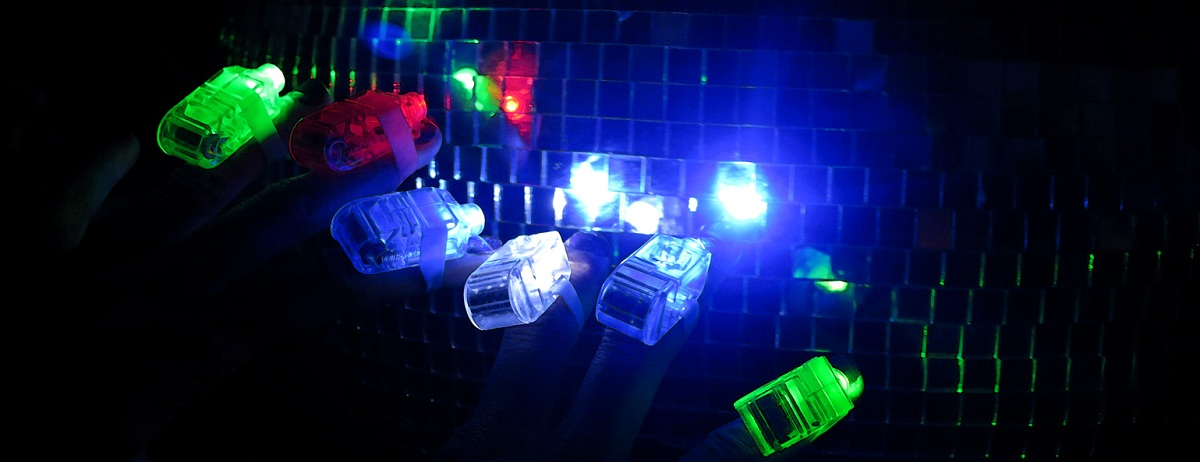 Glow Stick Rings for clubbers against disco ball Photo by David J Rodger