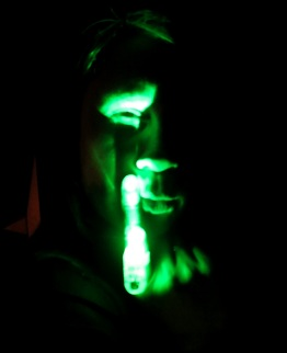 Green glow ring gives club girl spooky face Photo by David J Rodger