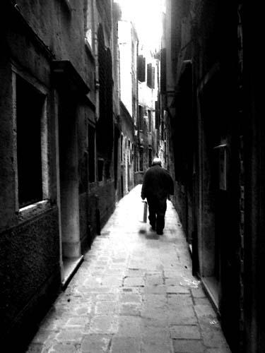 Travel Photo Venice Italy Copyright David J Rodger - Old Man Walks through lonely lanes