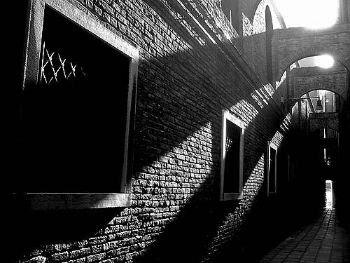 Travel Photo Venice Italy Copyright David J Rodger - Sunlight filters through narrow alley