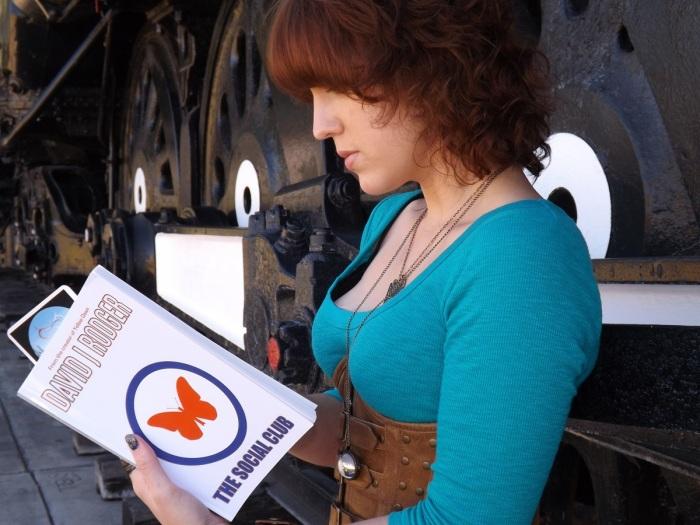 Arizona girl enjoys advance copy of The Social Club a new novel by British Science Fiction Dark Fantasy author David J Rodger - set in world of Yellow Dawn