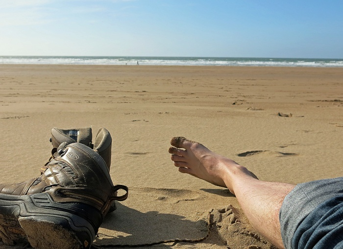Travel Photo England Devon Ilfracombe by David J Rodger - shoes off lying on the beach at Woolacombe