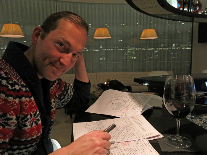 David J Rodger in bar of Wyndham Grand Hotel - Berlin - working on notes for new novel Oakfield
