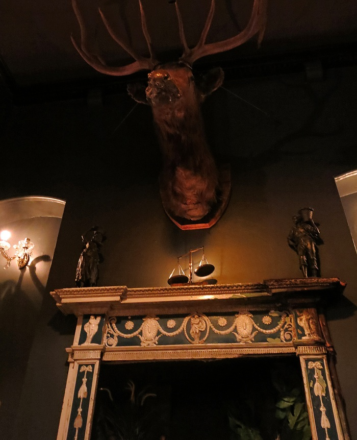 Milk Thistle cocktail bar speakeasy Bristol England - deer head mounted above fireplace