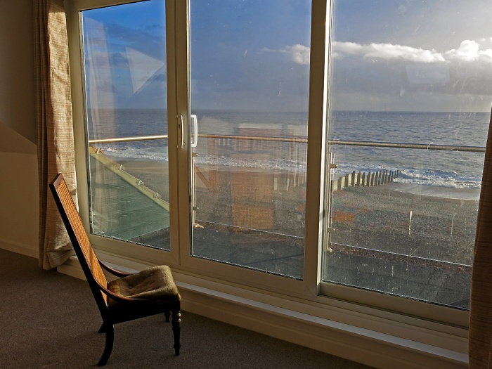 A chair overlooking sea at sunset - writers retreat Hayling Island England photo by David J Rodger