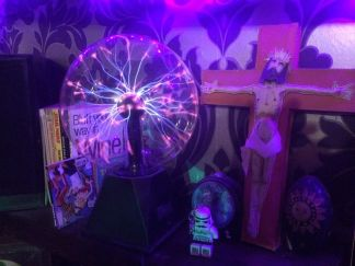 HIAB_X converts a garden shed into creative batchelor pad or Man Cave - plasma ball and home made jesus on crucifix