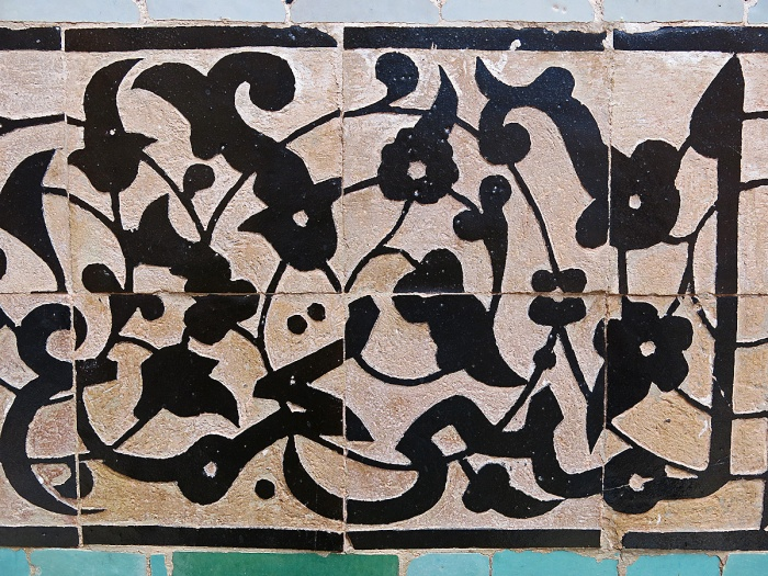 Morocco Marrakech Ben Youssef Medersa detail of caligraphy on frieze that spans walls