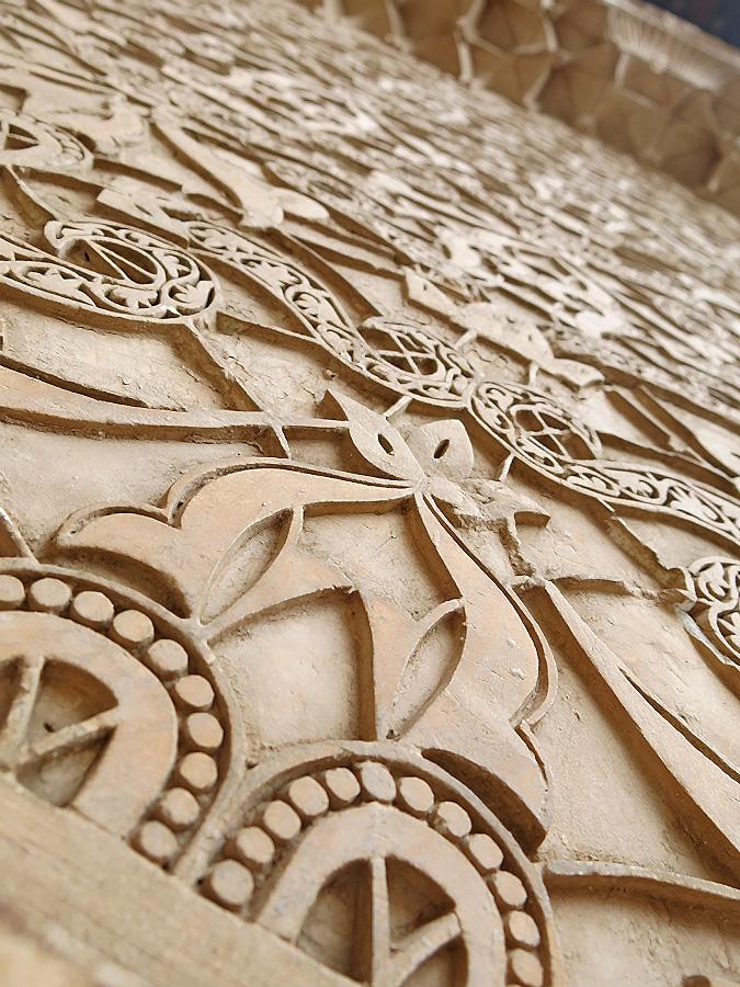 Morocco Marrakech Ben Youssef Medersa detail of fantastic intricate design on walls