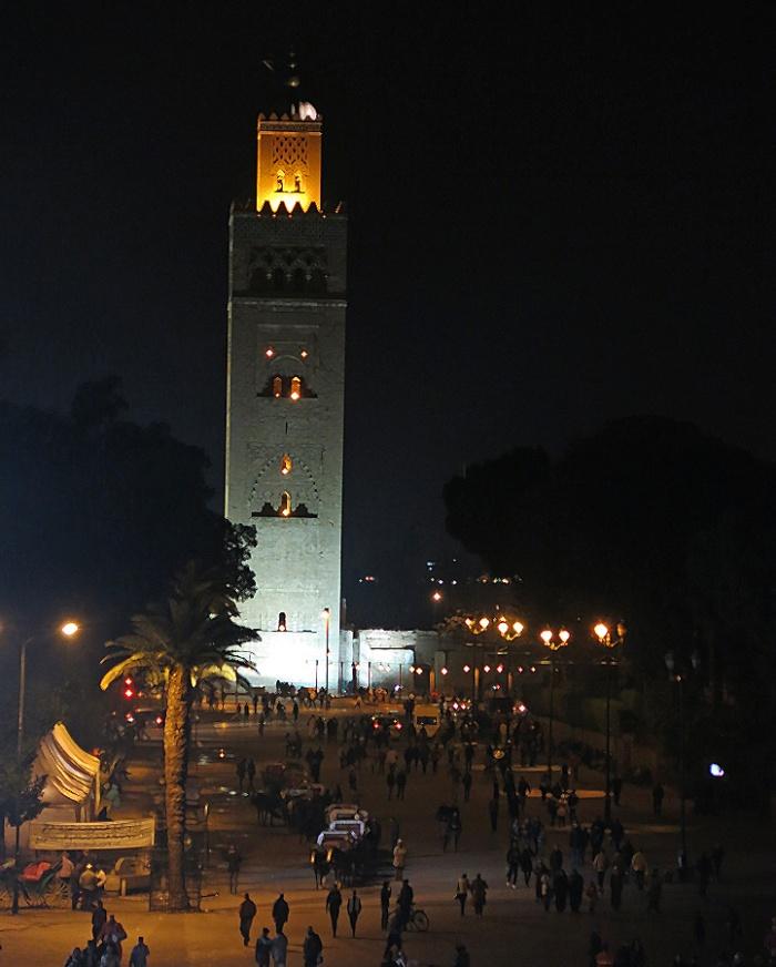 Morocco, Marrakech, looking down edge of Jemaa el-Fnaa towards main mosque