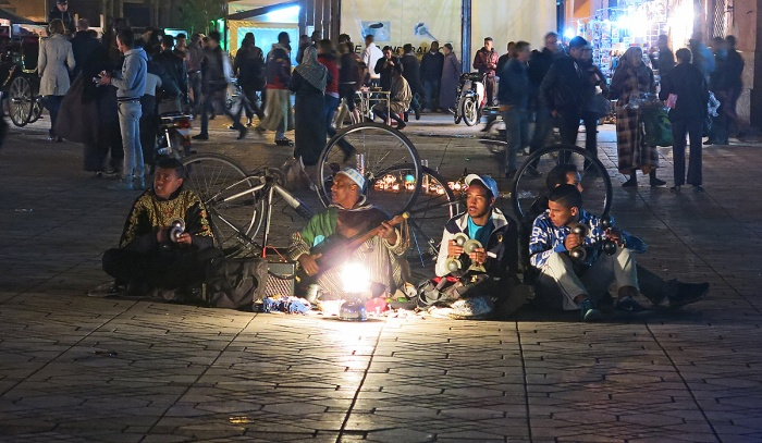 Morocco, Marrakech, street performers at night in Jemaa el-Fnaa