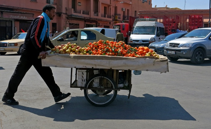 Marrakech street scene - fruit seller gets to work - outside Bahia Palace