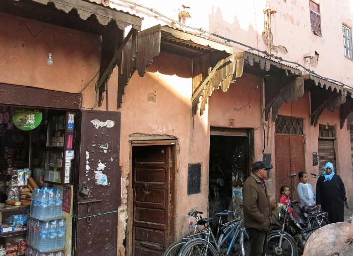 Morocco - Marrakech - street scene local shop and residents