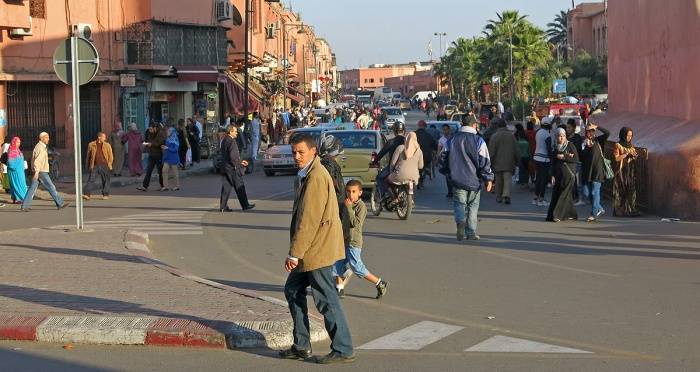 Morocco - Marrakech - street scene man crosses road boy stares