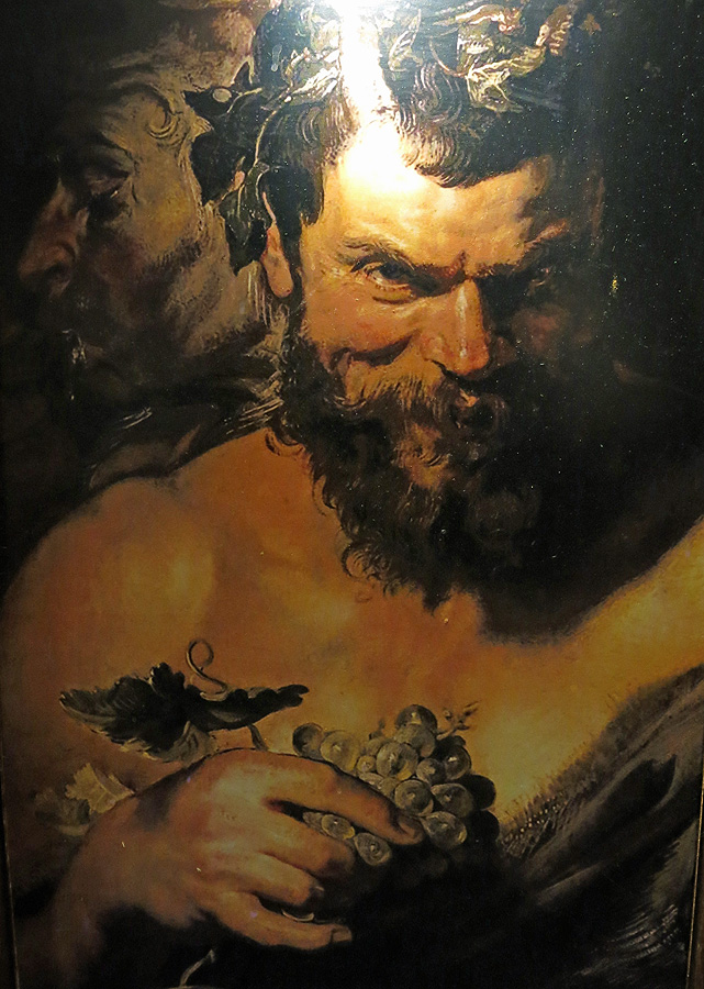 A portrait of Bacchus watches over diners at La Parrilla de San Lorenzo - Valladolid
