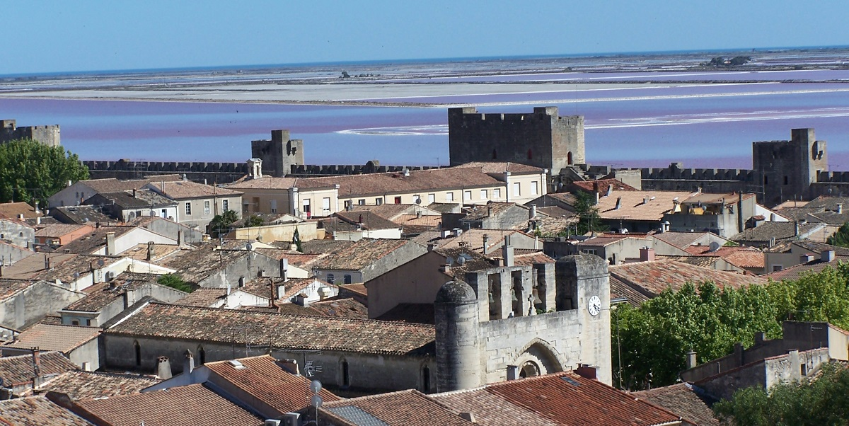 Aigues-Mortes view of the wall, rooftops within and salt lagoons and sea beyond