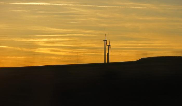 travel photo between Salamanca and Valladolid wind turbines overlook rural landscape