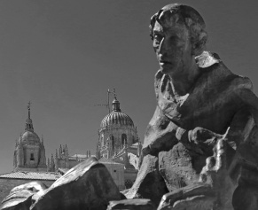 travel photo salamanca status of monk with book cathedral in background