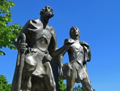travel photo statue of lazarus and boy