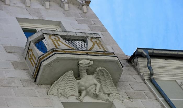 Travel photo - Valladolid Spain - dragon holding up window balcony