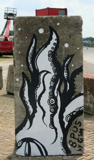 8 PUS by GSH - Cthulhoid resonator daubed on concrete monolith at NDSM Amsterdam