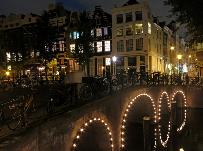 Amsterdam canal bridge at night