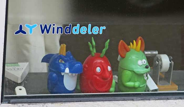 blue red and green monsters sit in window watching world go by - missing the party