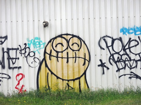 Graffiti Street Art at NDSM Werf Amsterdam - big yellow face